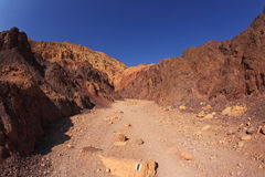 The marked tourist route. In ancient mountains of Sinai desert. Sunrise over Red sea royalty free stock image