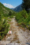 Marked tourist trail. View of marked tourist trail in mountain valley, Albanian Alps stock image