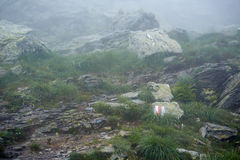 Marked trail on misty mountains Royalty Free Stock Photos