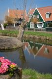 Marken - picturesque green wooden houses by a canal in the Dutch island and village Marken. Netherlands royalty free stock photos
