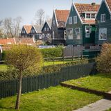 Marken - picturesque green wooden houses by canal in the Dutch island and village Marken. Netherlands royalty free stock photo