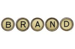 Markenwort in den Schreibmaschinenschlüsseln Stockfotografie