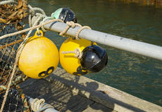 Marker buoys and lobster pots Royalty Free Stock Images