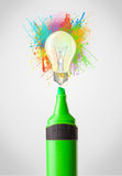 Marker close-up with colored paint splashes and lightbulb. Concept Stock Photo