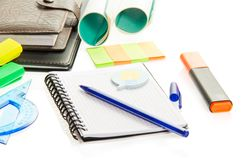 Marker, exercise book and leaflets for notes Royalty Free Stock Photography