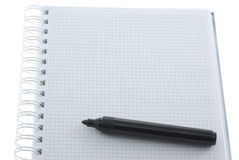 Marker on the notebook. Black marker on the notebook isolated on white Stock Image