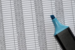 Marker over a excel spreadsheet with figures in Royalty Free Stock Photos