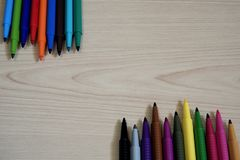 Marker Pens on wooden table background royalty free stock images