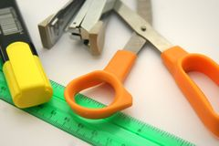 Marker, ruler, scissors and stapler. Office or school instruments on the table Royalty Free Stock Photography
