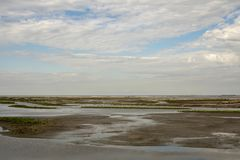 The Marker Wadden in the Netherlands with blue cloudy sky royalty free stock images