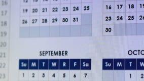 Markera datumet på kalender, organisation av arbetstid och att vila, årlig planläggning arkivfilmer