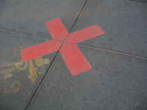 markerar röd fläck x Arkivfoto
