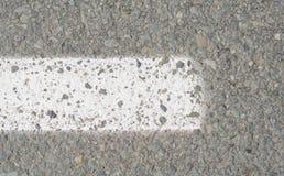 Markering på asfalt arkivfoto