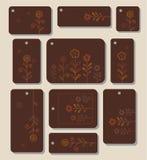 Markeringen, etiketten, bloemen, bladeren op een bruine achtergrond Royalty-vrije Stock Afbeelding