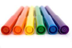 Markers. Rainbow colored markers against white background Stock Image