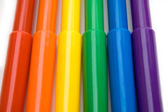 Markers. Rainbow colored markers against white background Royalty Free Stock Image