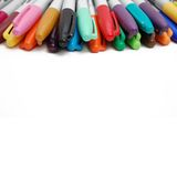 Markers background with empty space. A bunch of markers on the edge of a white background Royalty Free Stock Photo