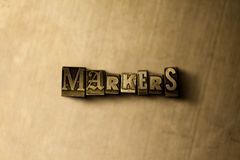 MARKERS - close-up of grungy vintage typeset word on metal backdrop Stock Photography