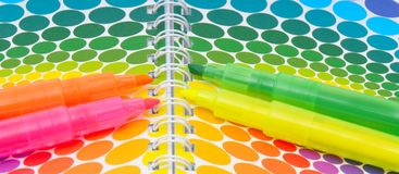 Markers and colorful notebook Royalty Free Stock Images