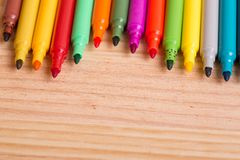 Markers. Colorful markers pens on a wooden table Royalty Free Stock Photography
