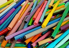 Markers of disorganized colors, textured background. Material, school, education, colorful, many, variety, set, multicolored, coloring, drawing, red, green, blue Royalty Free Stock Photography