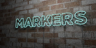 MARKERS - Glowing Neon Sign on stonework wall - 3D rendered royalty free stock illustration Royalty Free Stock Photos