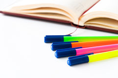 Markers and notebook Royalty Free Stock Images