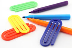 Markers and paper clips Royalty Free Stock Images