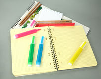 Markers pencils a writing-book Stock Images