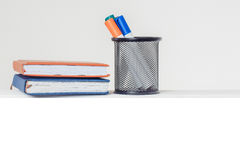 Markers in stand with notebooks Royalty Free Stock Image
