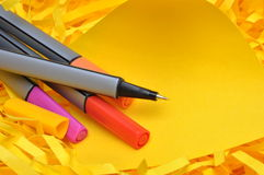 Markers with sticky note on shredded paper Stock Photos