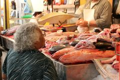 Market. A woman buys fresh fish from a market in Mexico Royalty Free Stock Image