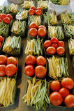 Market. Fresh fruits and vegetables, tomatoes and beans, on a marketplace Royalty Free Stock Photo