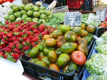 Market. Tomatoes, strawberries and artichokes in the market Royalty Free Stock Images