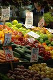 Market. Vegetables  at the market. A shopper stands in background Royalty Free Stock Images