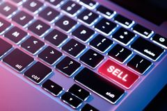 Computer keyboard with SELL button stock photography