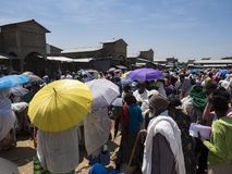 Market activity, many people with umbrellas royalty free stock image