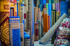 Market in Agadir, Morocco. In the afternoon, were sold here clothes, shoes,fabrics and rugs Stock Image