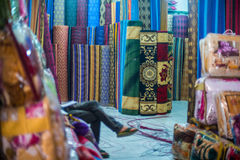 Market in Agadir, Morocco. In the afternoon, were sold here clothes, shoes,fabrics and rugs Stock Photos