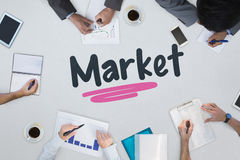 Market against business meeting Stock Images