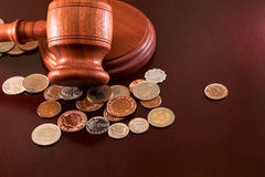 Market analysis. Coins of the world and auction hammer on the table Royalty Free Stock Photos