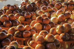 Market Apples Baskets. Market apples in autumn light Royalty Free Stock Photography