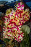 A market with an arrangement of flowers made of paper, in the city of Denpasar in Indonesia royalty free stock image