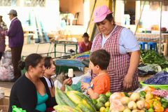 Market in Banos, Ecuador. BANOS, ECUADOR - FEBRUARY 26, 2014: Unidentified people on the market on Plaza 5 de Junio on February 26, 2014 in Banos, Ecuador. On Stock Images