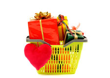 Market basket full of presents and a red heart. Royalty Free Stock Photography