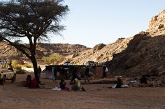 Market Bedouin in the desert. The women of the oasis sell items to get money Royalty Free Stock Photo