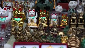 Market in Beijing. traditional Chinese souvenirs. Ceramic cats waving his hand hello stock video