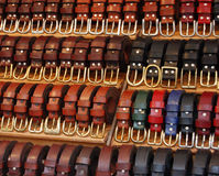 Market belts. Display of leather belts at a market stall in Monpazier, France Stock Photos