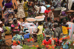 Market in Benin, Africa. People selling and buying goods in an open air market in Benin, Africa royalty free stock image