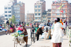 Market on the bridge. KADMANDU, NEPAL - DECEMBER 18 :  Many people go shopping at the market in the morning on December 18,2012 at Kadmandu, Nepal. The market is Royalty Free Stock Photography